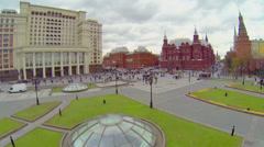 People walk by Maneznaya square near Kremlin complex Stock Footage