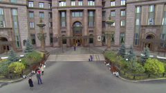 People walk near entrance of Stalins skyscraper Stock Footage