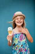 young girl holding ice cream cone - stock photo