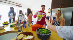 Cheerful attractive group of friends socializing at home with drinks Stock Footage