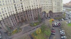 People walk near house on Kotelnicheskaya quay Stock Footage