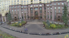 People walk near entrance of house on Kotelnicheskaya quay Stock Footage