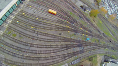 Electric locomotive rides from depot with many railroad tracks Stock Footage