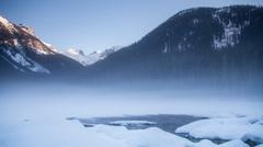 Winter fog at frozen Joffrey lake Stock Footage