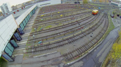 Electric locomotive rides to depot with many railway tracks Stock Footage