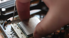 Removing processor from motherboard Stock Footage