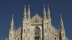 The famous facade of the Duomo di Milano Cathedral in Milan, Italy Stock Footage