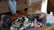 Stock Video Footage of a toddler sick with flu watching a tablet near mother