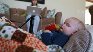 Stock Video Footage of a toddler sick with a flu watching tablet near mother
