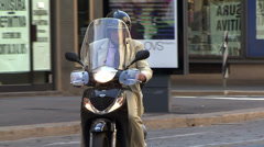 An Italian on a moped in Milan, Italy Stock Footage
