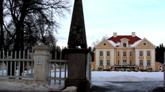 Entrance gate of a big old manor house in estonia baltic with fence Stock Footage