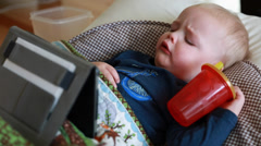 A toddler sick with the flu watchin a tablet Stock Footage