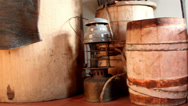 Three wooden barrels and an old lamp Stock Footage