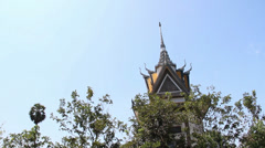 Wide shot tilt down from Killing Fields shrine to Mass grave #2 Stock Footage