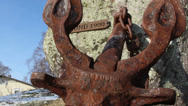 Stock Video Footage of a rusty anchor from a rock