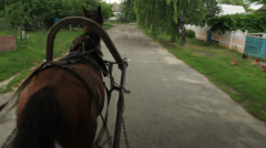 Horse carrying cart takes turn on village suburban crossroad, click for HD Stock Footage