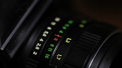 Close shot of a man rotating the aperture value ring on an old SLR camera Stock Footage