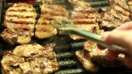 Stock Video Footage of Pork steaks on barbecue grill