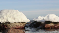 Snow on top of the big rocks Stock Footage