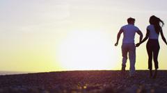 Romantic couple running on the beach at sunset - stock footage