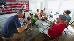 Happy group of family and friends, socializing together at the dinner table  Stock Footage