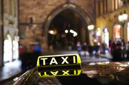Stock Photo of Taxi in night city