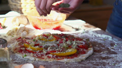 Sprinkle seasonings on tasty pizza, super slow motion, shot at 240fps HD - stock footage