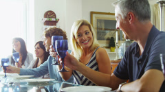 Happy group of family and friends, socializing together at the dinner table  - stock footage