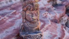 Mayan Statue on Rock Ledge Close Up Tilt and Pan Stock Footage
