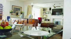Interior view of dining area in a stylish beachside home  - stock footage