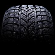 Car tire on black background Stock Photos