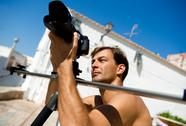 Stock Photo of handsome man with camcorder outdoors