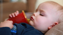 Little boy resting sick with the flu Stock Footage