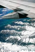 alps, aerial view from window of airplane - stock photo
