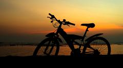 Stock Photo of mountain bike silhouette with sunset sky
