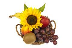 Decor of fruit basket with sunflower Stock Photos