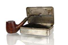 Antique pipe with shag box isolated in white Stock Photos