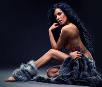 gorgeous sexy brunette in fur posing indoors - stock photo