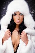 beautiful woman in white fur coat and cap - stock photo