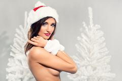 Beautiful female wearing christmas hat Stock Photos