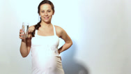 Stock Video Footage of Pregnancy_Woman_Drinks_Milk,Woman_Drinks_Juice_During_Pregnancy