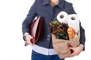 Stock Photo of businesswoman grocery shopping