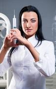 Attractive woman with medical syringe Stock Photos