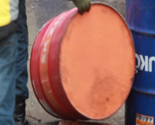 Rolling color barrels with flammable liquid, dangerous usage , click for HD - stock footage