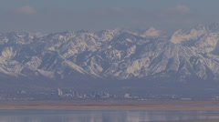 Salt Lake City, Utah with snow covered mountains towering above - stock footage