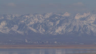 Stock Video Footage of Salt Lake City, Utah with snow covered mountains towering above
