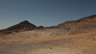 Stock Video Footage of Panoramic view on a volcanic mountain in the Black Desert, Egypt