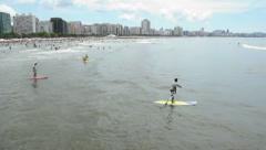 Man paddle surfing, Santos Beach, Sao Paulos litoral coast. Brazil Stock Footage