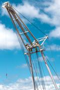 Barge crane over blue sky background Stock Photos