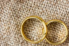 Golden rings on the burlap Stock Photos